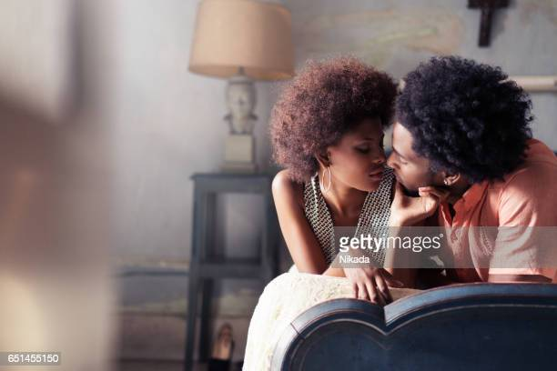 passionate couple relaxing on bed at home - black people kissing stock pictures, royalty-free photos & images