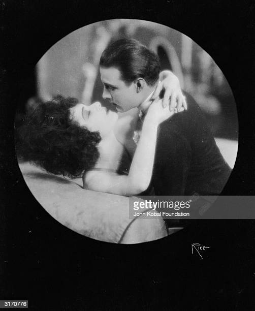 A passionate embrace between Alla Nazimova and screen idol Rudolph Valentino the screen name of Rodolpho d'Antonguolla in the 1921 version of...