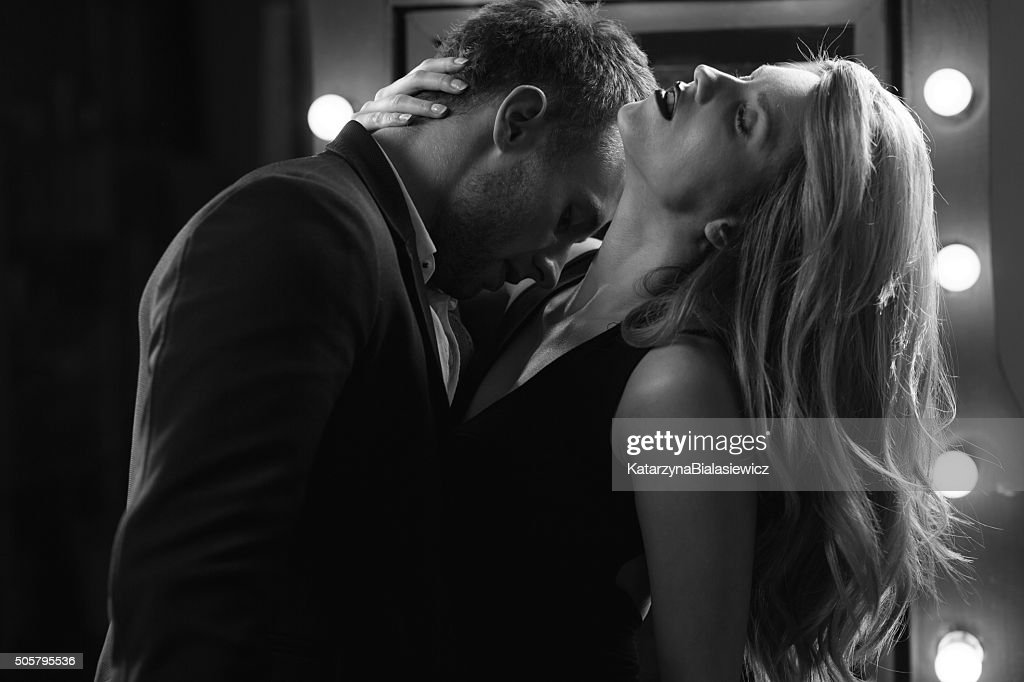 Passionate Foreplay Between Lovers Stock Photo