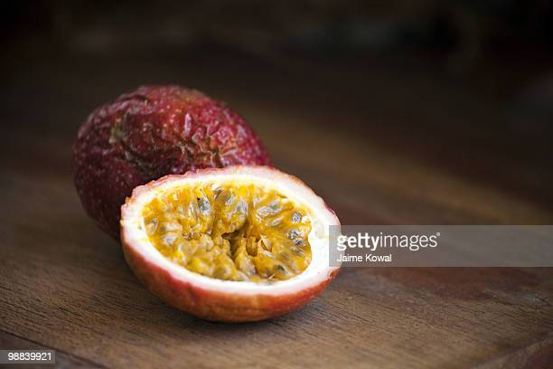 Passionfruit still life with dark wood background