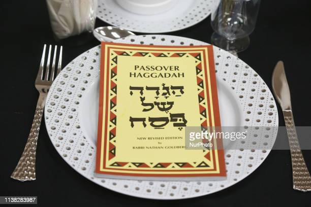 Passover Haggadah rests on a plate during a Passover seder in North York Ontario Canada on April 19 2019