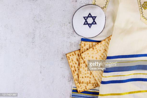 passover matzoh jewish holiday bread with kipah - jewish prayer shawl stock pictures, royalty-free photos & images