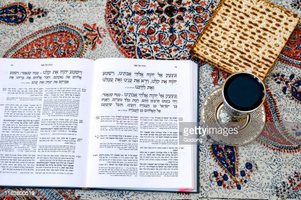 Passover Seder Haggadah in a Jerusalem jewish home with wine and matsa