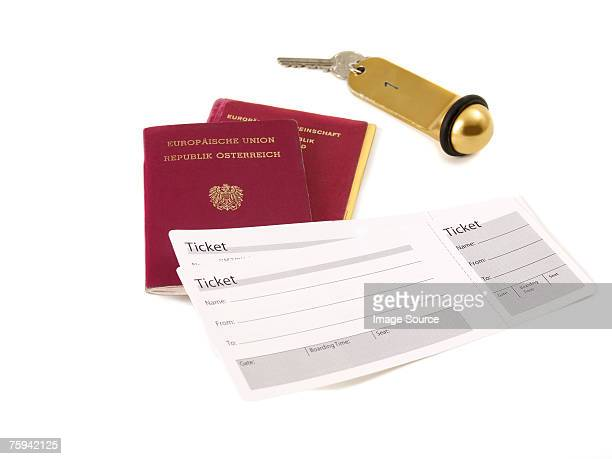 Passport airplane ticket and hotel key