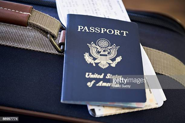 passport and airplane ticket on suitcase