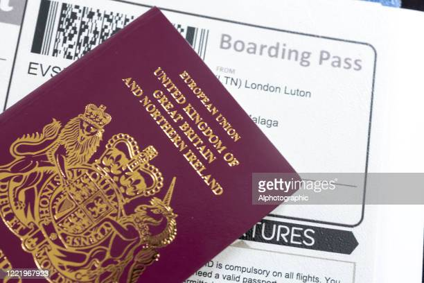uk passport and boarding card - british culture stock pictures, royalty-free photos & images