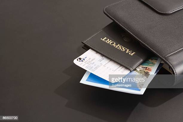 Passport and plane ticket in daily planner