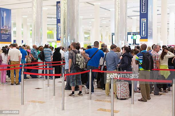 passport control at the airport in dubai,united arab emirates - identity card stock pictures, royalty-free photos & images