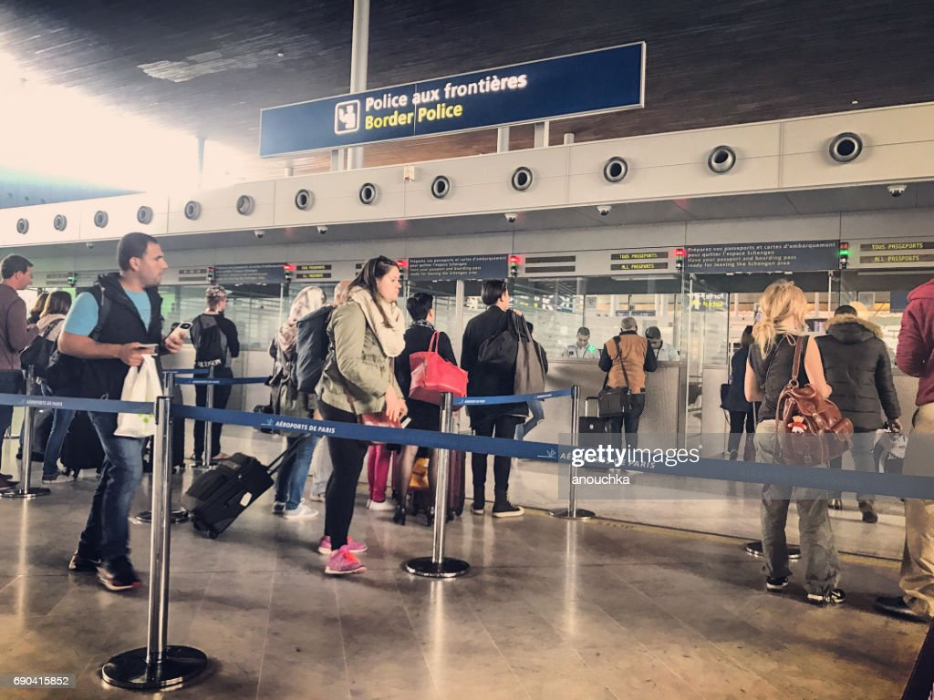 Passport control in Roissy Charles de Gaulle Airport, Paris, France : Stock Photo