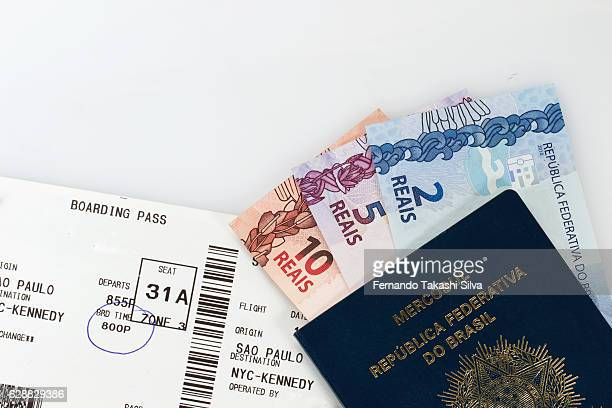 Passport, currency and a boarding pass