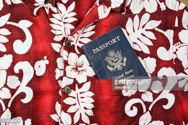 passport for tropical vacation - hawaiian shirt stock photos and pictures