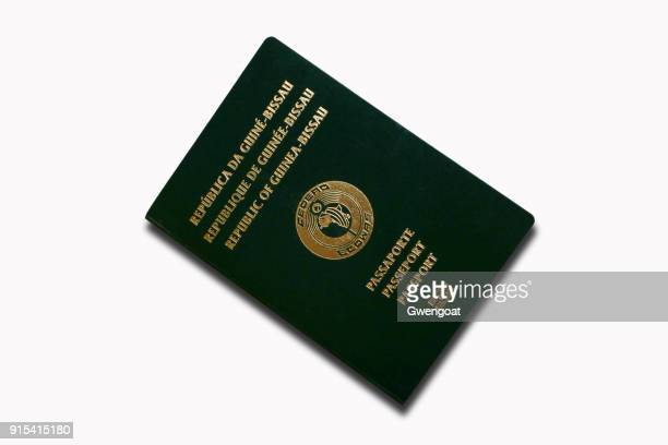 passport from guinea-bissau isolated on a white background - gwengoat stock pictures, royalty-free photos & images