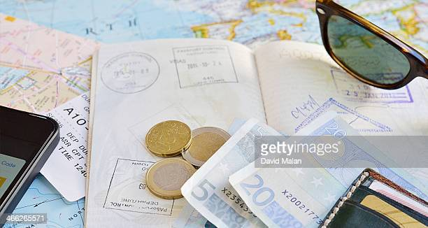 Passport, maps, money, boarding pass etc