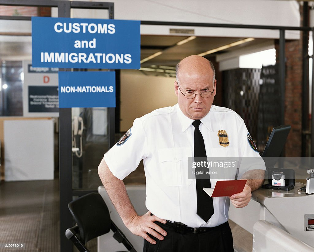 Passport Officer at Airport Security : Stock Photo