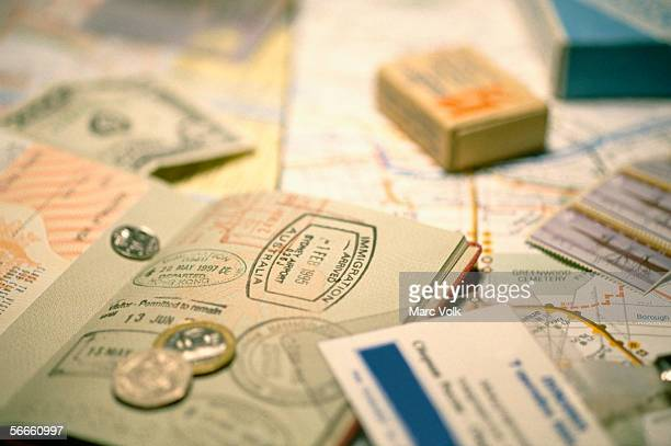 A passport, papers and coins