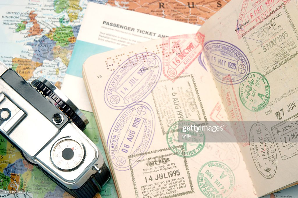 Passport Travel Stamps With A Camera And World Map