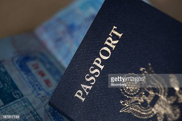 US passports are arranged for a photograph in New York US on Tuesday April 23 2013 A court challenge by federal immigration agents seeking to block...