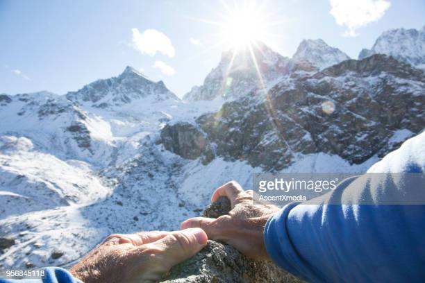 pov past climber hands on rock to mountains in distance - freezing motion photos stock pictures, royalty-free photos & images