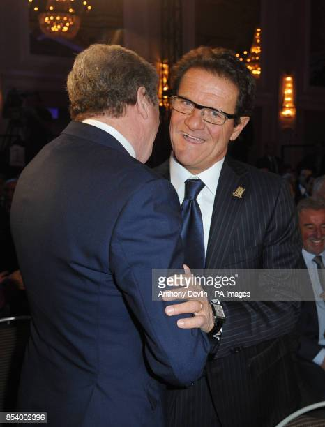 Past England manager Fabio Capello greets current manager Roy Hodgson during the FA Anniversary Celebrations Launch at the Grand Connaught Rooms...
