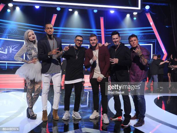 Past 'Ink Master' winners Ryan Ashley Anthony Michaels Joey Hamilton and Steven Tefft pose for a photo with Season 9 Winners DJ Tambe and Bubba Irwin...
