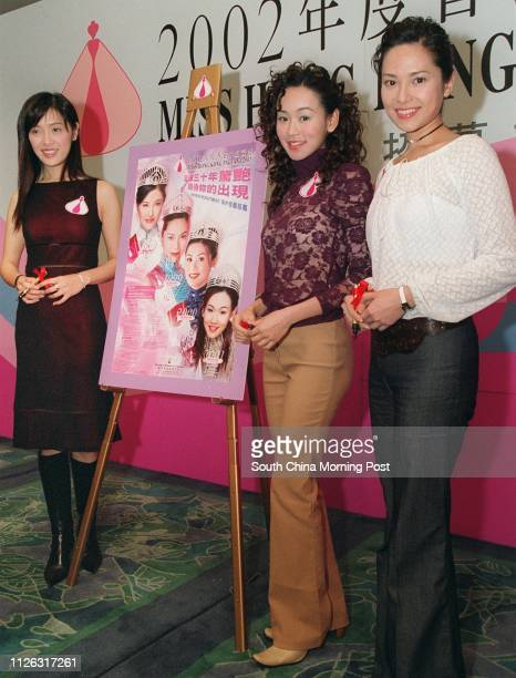 Past Miss Hong Kong winners Anne Heung Hoilan Shirley Yeung Szeki and Sonija Kwok autograph a poster being used to recruit overseas contestants as...
