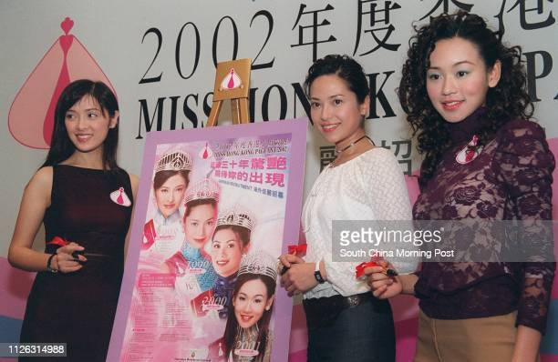 Past Miss Hong Kong winners Anne Heung Hoilan Sonija Kwok and Shirley Yeung Szeki autograph a poster being used to recruit overseas contestants as...