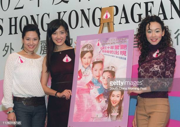 Past Miss Hong Kong winners Sonija Kwok Anne Heung Hoilan and Shirley Yeung Szeki autograph a poster being used to recruit overseas contestants as...