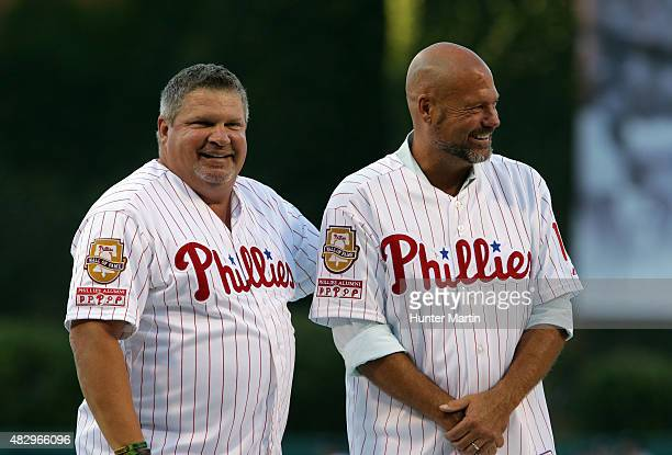 Past players Darren Daulton and John Kruk of the Philadelphia Phillies during the Pat Burrell Wall of Fame Induction ceremony before a game against...