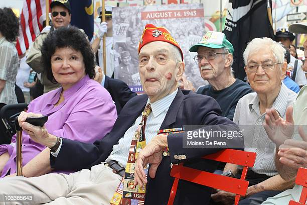 Past war veterans attend the Kiss-In event commemorating the 1945 victory kiss photo by Alfred Eisenstadt in Times Square on August 14, 2010 in New...