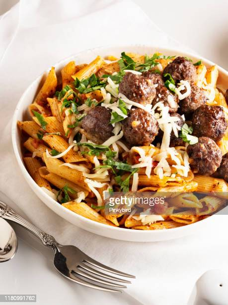 pasta and meatballs, penne pasta with meatballs in tomato sauce, penne pasta with meatballs - savory food stock pictures, royalty-free photos & images