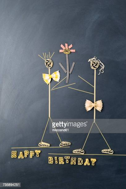 pasta image with male and female likeness at birthday - funny birthday stock photos and pictures