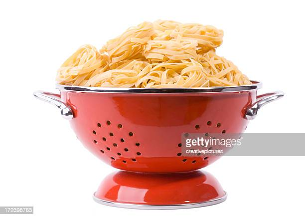 pasta in colander - colander stock photos and pictures