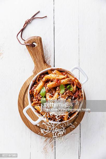Pasta Penne with bolognese sauce and parmesan cheese