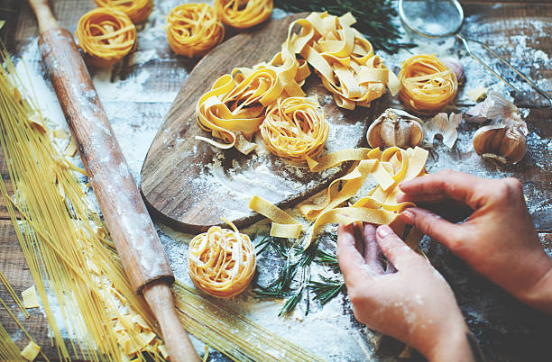 pasta - preparation stock pictures, royalty-free photos & images