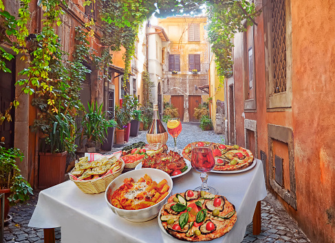 Pasta , pizza  and homemade food arrangement  in a restaurant  Rome 891284194