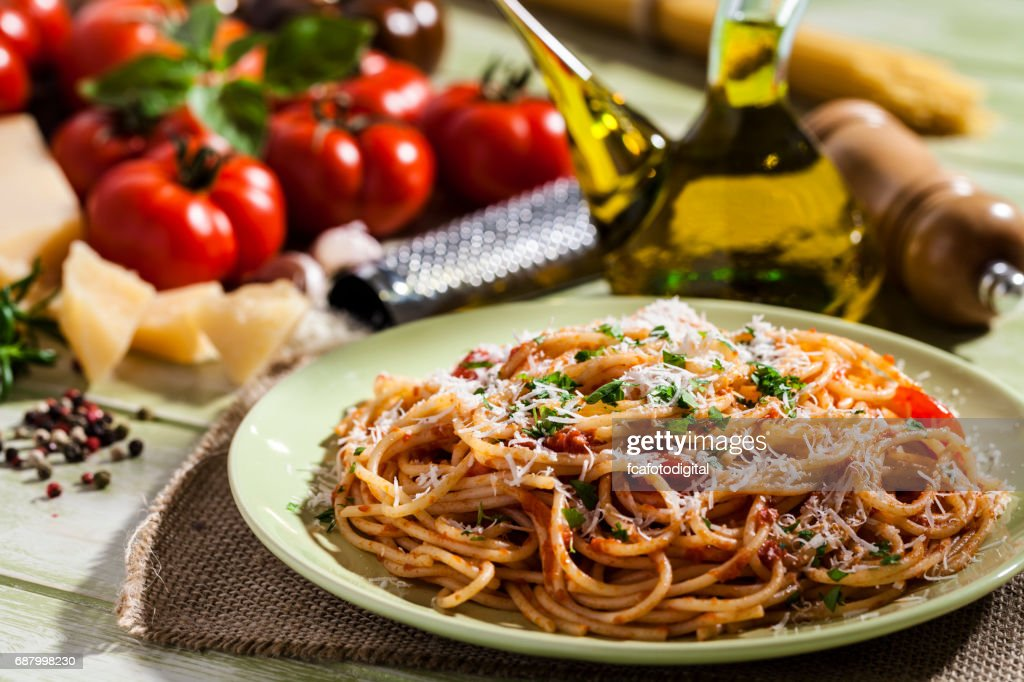 kitchen table with food. Pasta Plate And Ingredients On Green Kitchen Table : Stock Photo With Food