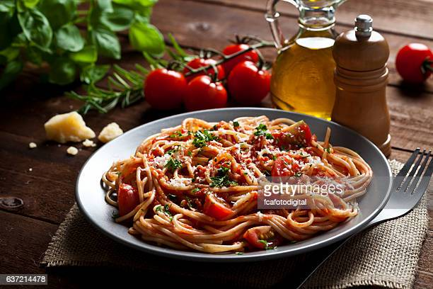 pasta plate - tomato sauce stock pictures, royalty-free photos & images