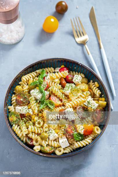 pasta salad with feta cheese and fresh tomatoes - feta cheese stock pictures, royalty-free photos & images