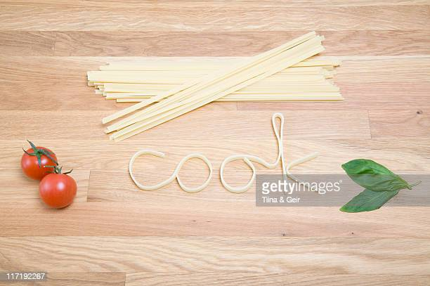 Pasta spelling out the word cook