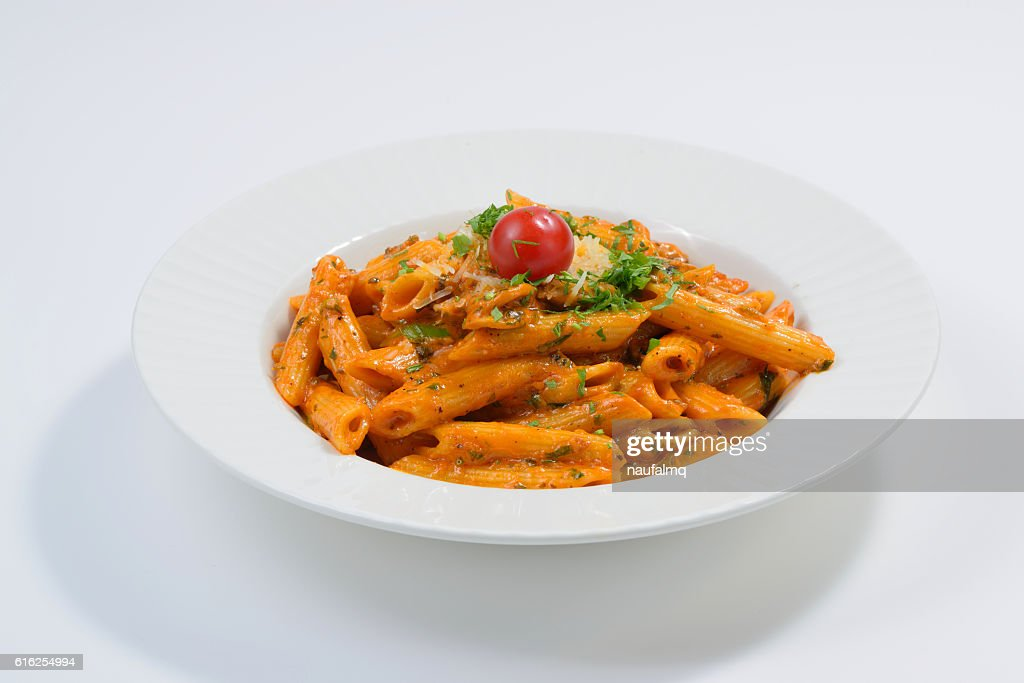 Pasta tagiatelle with tomato : Stock Photo