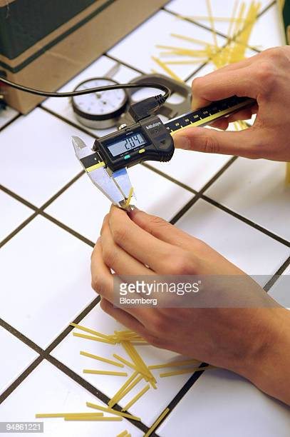 Pasta thickness is measured with a caliper to make sure it meets the standards at the Delverde pasta factory in Fara San Martino Italy on Wednesday...