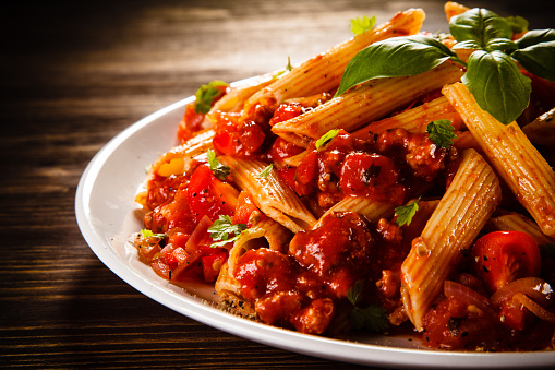 Pasta with meat, tomato sauce and vegetables 857927726