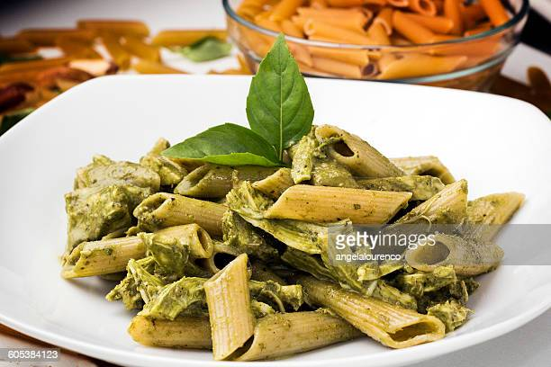 pasta with pesto and shredded chicken - pesto stock pictures, royalty-free photos & images