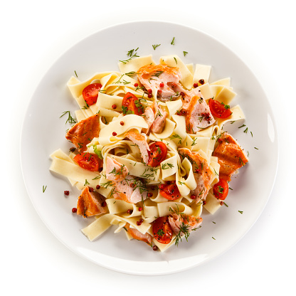 Pasta with salmon and vegetables on white background 1079928664