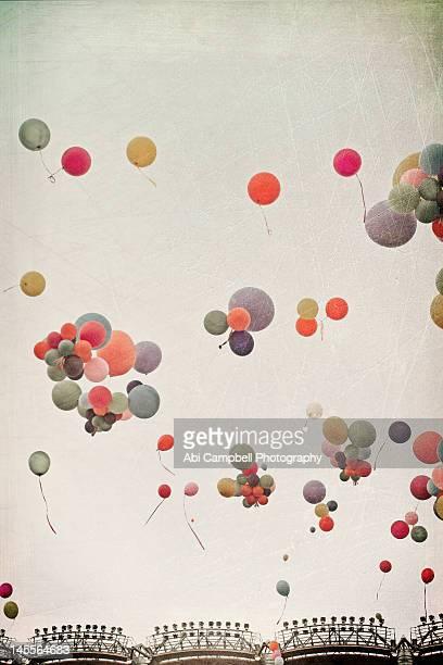 Pastel balloons in sky