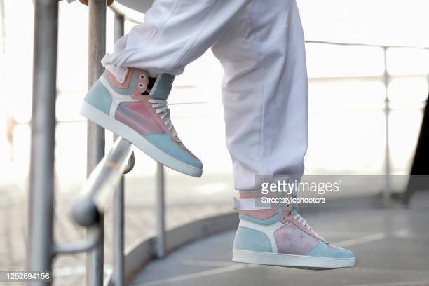 Pastel blue and pink rivoli sneaker by Louis Vuitton as a detail of influencer Andre Borchers during a street style shooting on June 12, 2020 in...