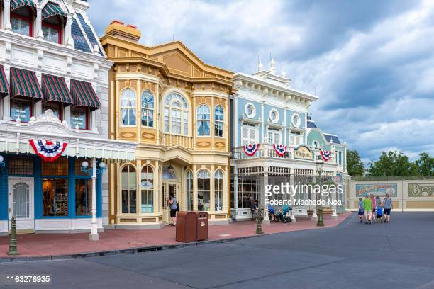 Pastel colored buildings exterior in the Walt Disney's Magic Kingdom Park. A tourist view of the beautiful architecture inside of the famous place...