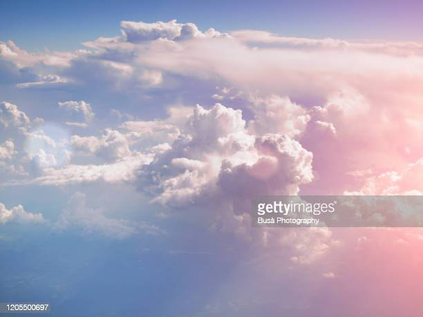 pastel colored clouds, view of the sky from aircraft - daydreaming stock pictures, royalty-free photos & images