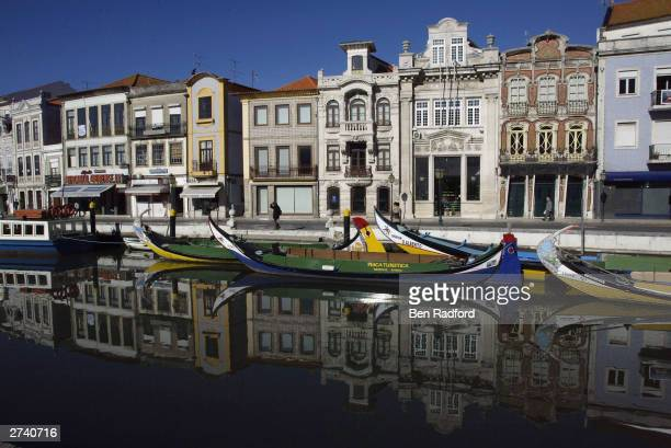 Pastel colored houses are reflected in the San Roque canal November 18 2003 in the centre of Aveiro Portugal Aveiro is one of the host cities for the...