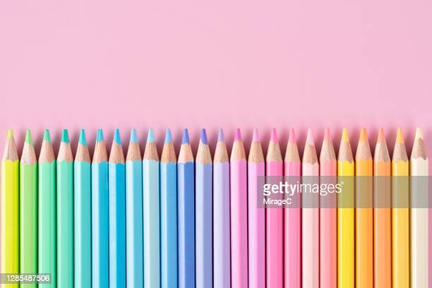 pastel colored pencils on pink - pastel stock pictures, royalty-free photos & images